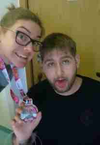 Amie with Andrew and her Yorkshire Marathon medal after fundraising for Sheffield Palliative Care Unit