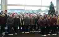 School Kids Spread Festive Cheer to Shoppers