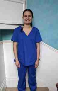 Louise Calwell wearing a set of the scrubs she made.